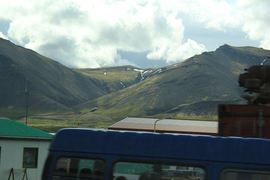 A view of the mountains out of the bus window on the way to Deildartunguhver to see the hot spring